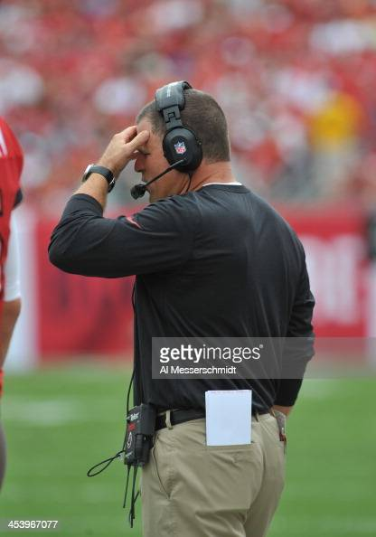 Coach Greg Schiano of the Tampa Bay Buccaneers directs play against the Atlanta Falcons November 17 2013 at Raymond James Stadium in Tampa Florida...