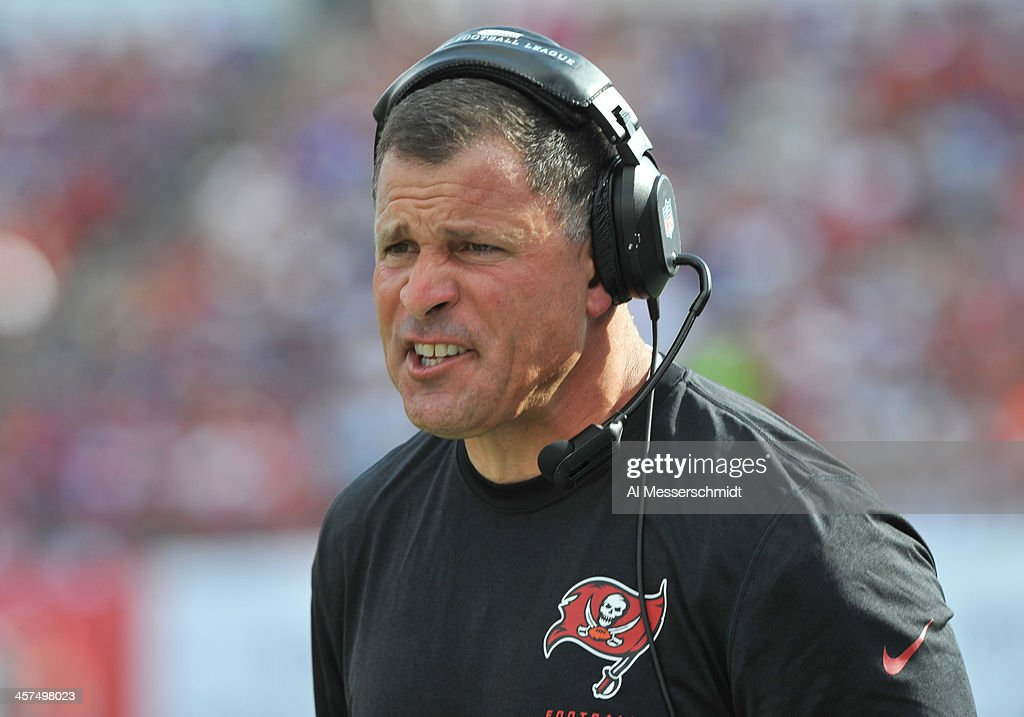 Coach Greg Schiano of the Tampa Bay Buccaneers directs play against the Buffalo Bills December 8 2013 at Raymond James Stadium in Tampa Florida The...