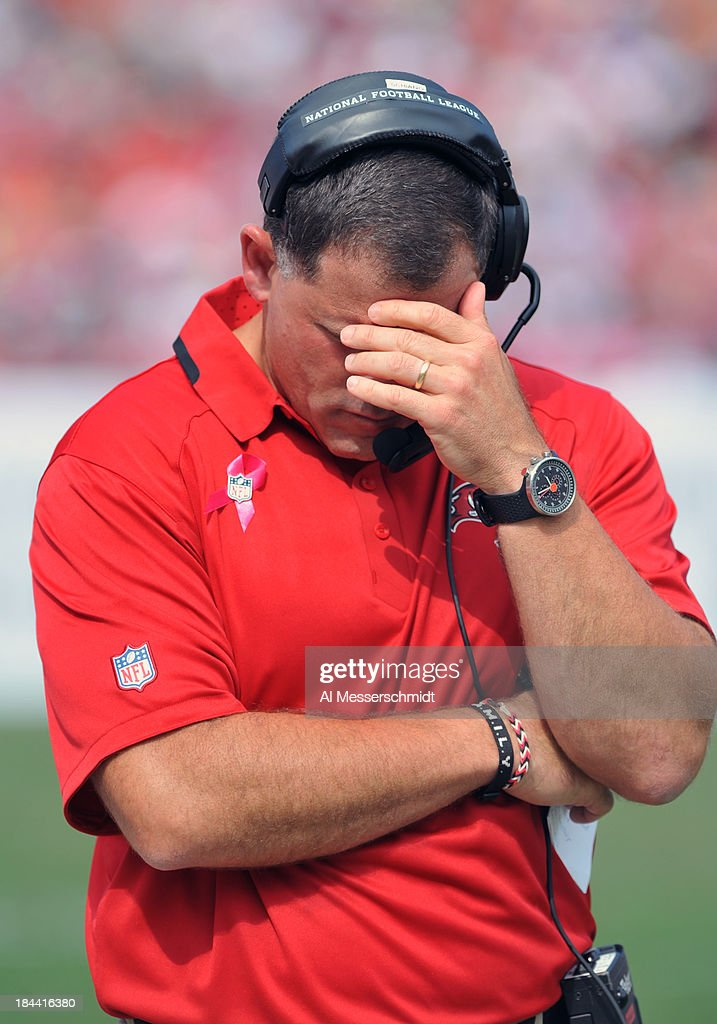 Coach Greg Schiano of the Tampa Bay Buccaneers reacts after the Philadelphia Eagles score in the 2nd half October 13 2013 at Raymond James Stadium in...