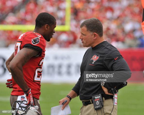 Coach Greg Schiano of the Tampa Bay Buccaneers talks with cornerback Johnthan Banks during play against the San Francisco 49ers December 15 2013 at...