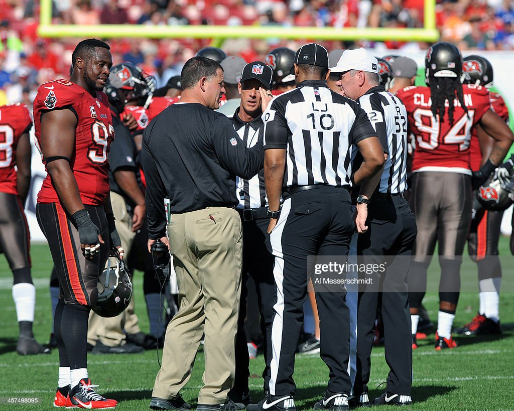 Coach Greg Schiano of the Tampa Bay Buccaneers talks with NFL officials during play against the Buffalo Bills December 8 2013 at Raymond James...