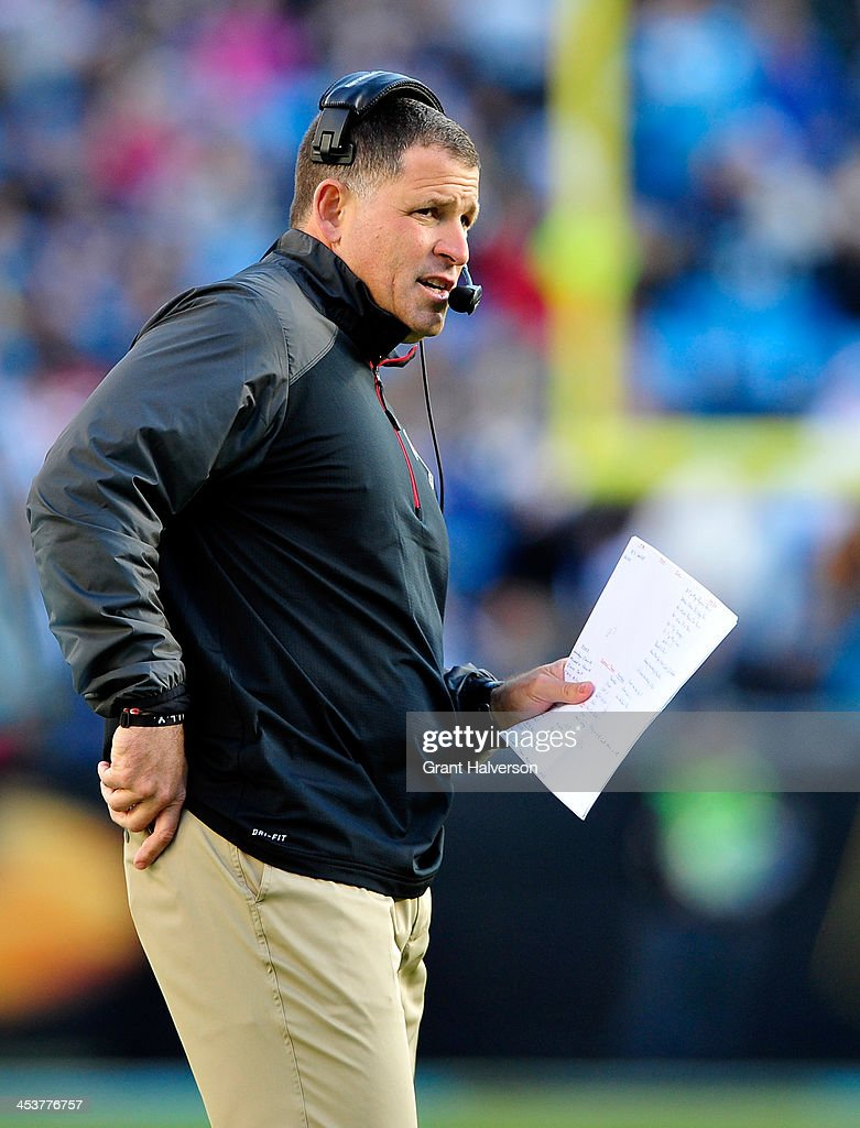 Coach Greg Schiano of the Tampa Bay Buccaneers watches his team play against the Carolina Panthers at Bank of America Stadium on December 1 2013 in...