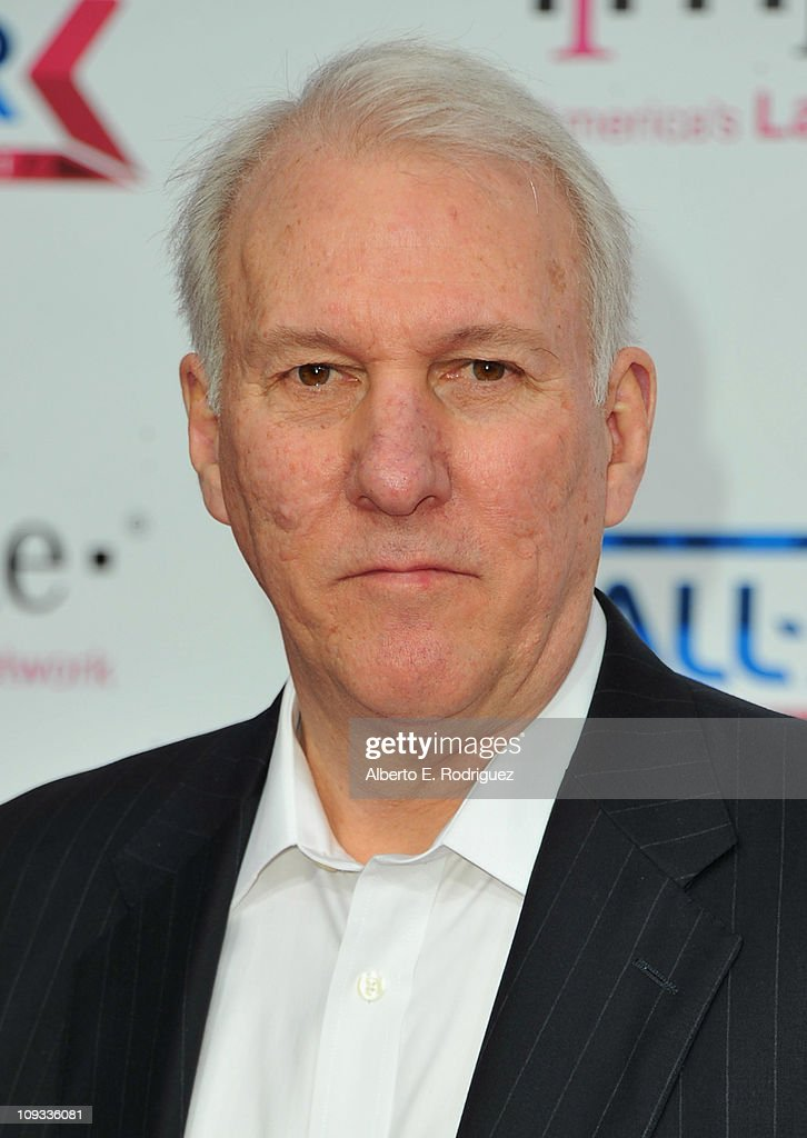 NBA coach <a gi-track='captionPersonalityLinkClicked' href=/galleries/search?phrase=Gregg+Popovich&family=editorial&specificpeople=202904 ng-click='$event.stopPropagation()'>Gregg Popovich</a> arrives to the T-Mobile Magenta Carpet at the 2011 NBA All-Star Game on February 20, 2011 in Los Angeles, California.