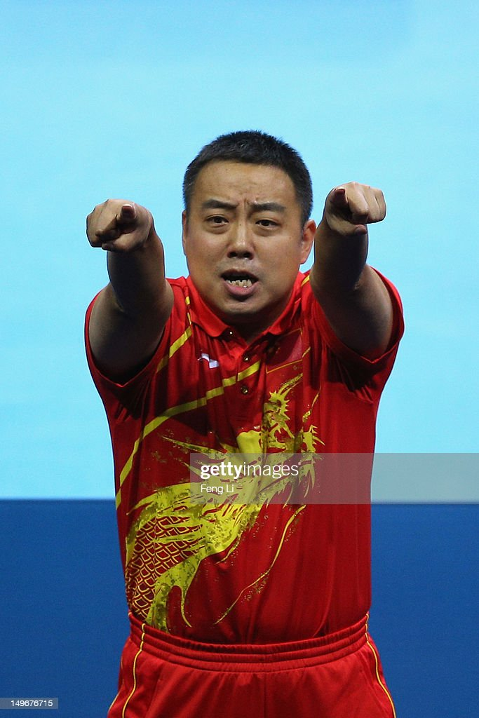 Coach Guoliang Liu of China and celebrates after Men's Singles Table Tennis semifinal matches on Day 6 of the London 2012 Olympic Games at ExCeL on August 2, 2012 in London, England.