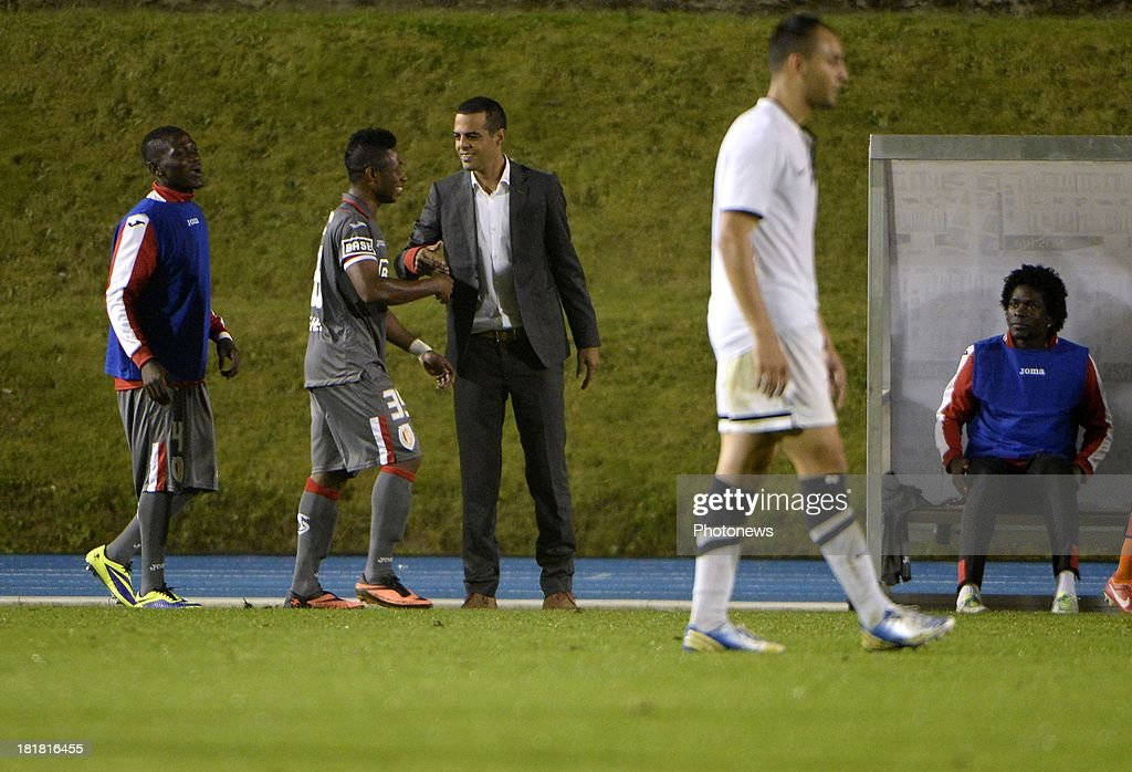 coach Guy Luzon of Standard Liege and Imoh Ezekiel of Standard Liege celebrates the win pictured during the Cofidis Cup match between White Star and Standard of Liege on september 25 , 2013 in Woluwe, Belgium.