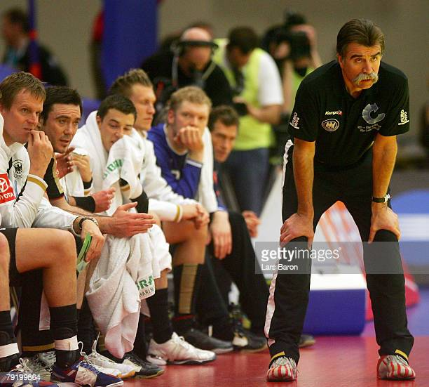 Coach Heiner Brand of Germany looks on next to his players during the Men's Handball European Championship main round Group II match between Germany...