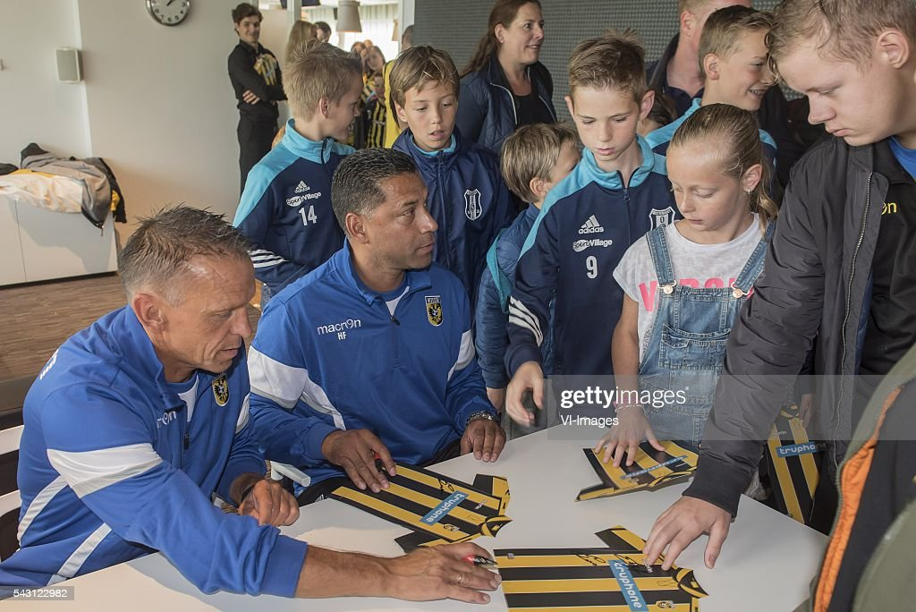 coach Henk Fraser of Vitesse and assistent trainer Edward Sturing are giving autographs to supporters during the first training session of the season 2016/2017 on June 26, 2016 at Papendal, The Netherlands