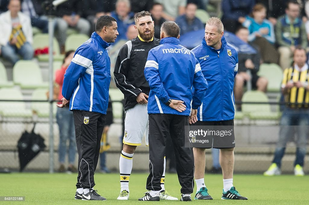 coach Henk Fraser of Vitesse and assistent trainer Edward Sturing of Vitesse tell Guram Kashia of Vitesse that the training is definitely cancelled during the first training session of the season 2016/2017 on June 26, 2016 at Papendal, The Netherlands