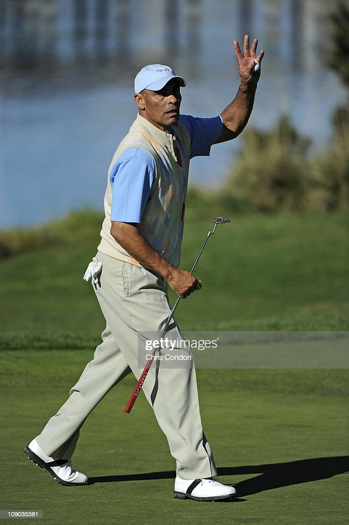 NFL coach Herm Edwards waves to the gallery on the 5th green during the third round of the ATT Pebble Beach National ProAm at Pebble Beach Golf Links...