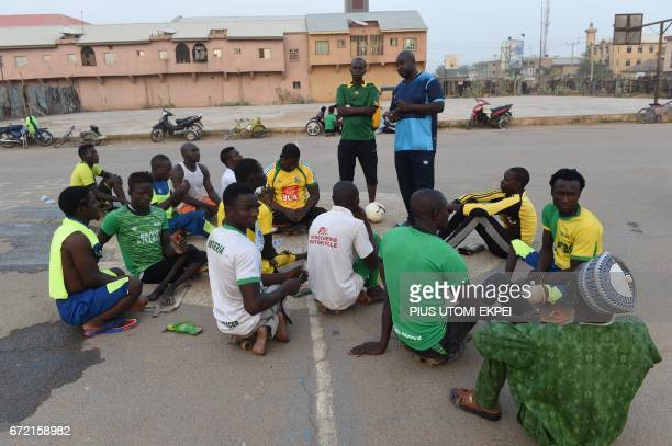 Coach Ibrahim Musa speaks to Kano Pillars parasoccer players during a training session in Kano northwestern Nigeria on April 22 2017 The World Health...