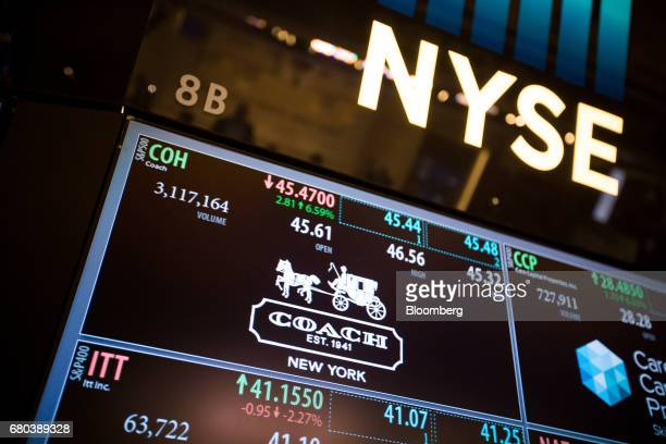 Coach Inc signage is displayed on a monitor on the floor of the New York Stock Exchange in New York US on Monday May 8 2017 US stocks slipped from...