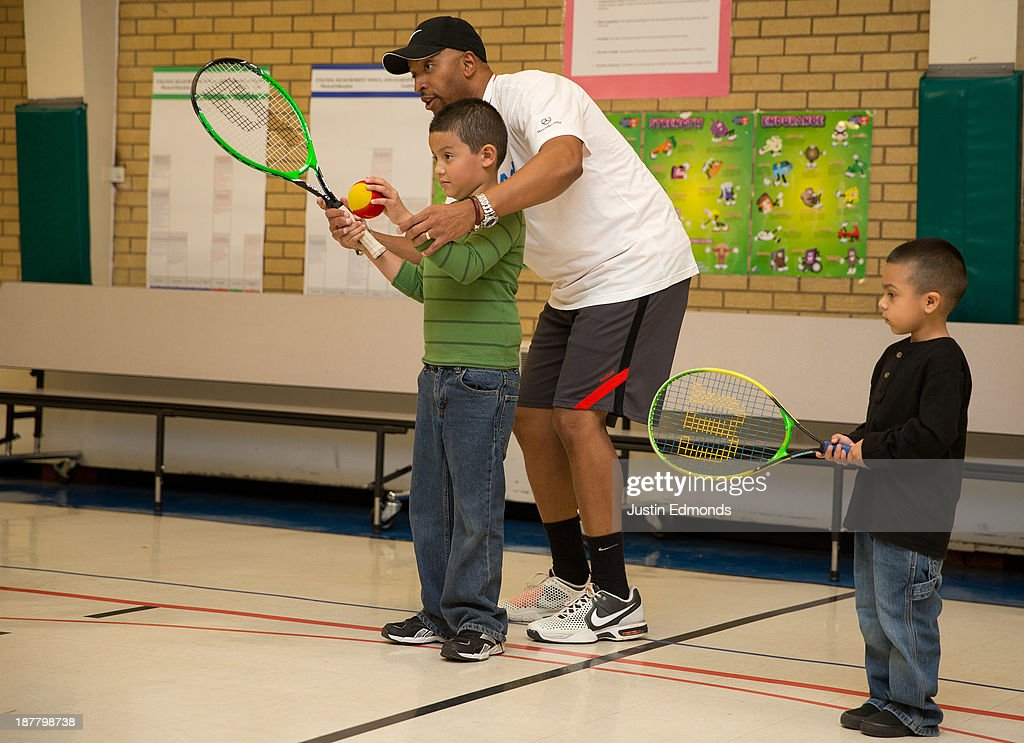 A coach instructs kids on proper tennis technique during the Denver Project Launch to support Up2Us Coach Across America program at the Adams 50 USTA National Junior Tennis Learning Chapter inside Sunset Ridge Elementary School on November 12, 2013 in Westminster, Colorado.