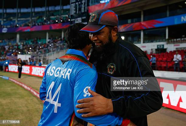 Coach InzamamulHaq of Afghanistan hugs his captain Asghar Stanikzai as they celebrate their victroy during the ICC World Twenty20 India 2016 Group 1...