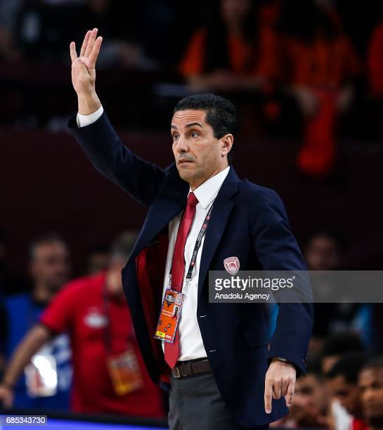 Coach Ioannis Sfairopoulos of Olympiacos gives tactics during the Turkish Airlines Euroleague Final Four basketball match between CSKA Moscow and...