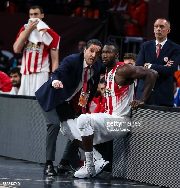 Coach Ioannis Sfairopoulos of Olympiacos gives tactics to Patrick Young during the Turkish Airlines Euroleague Final Four basketball match between...