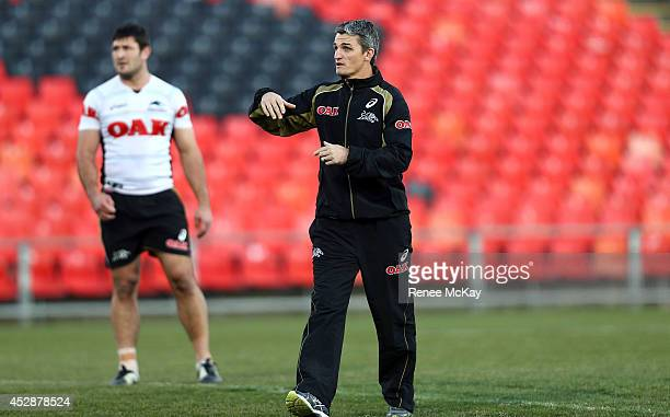 Coach Ivan Cleary instructs his players during a Penrith Panthers NRL training session at Centrebet Stadium on July 29 2014 in Penrith Australia