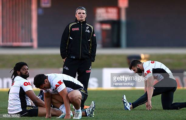 Coach Ivan Cleary talks with his players during a Penrith Panthers NRL training session at Centrebet Stadium on July 29 2014 in Penrith Australia