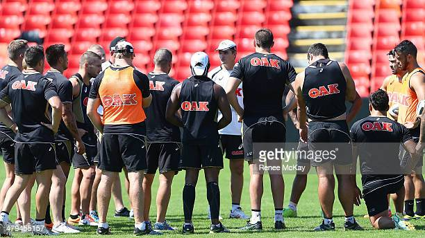 Coach Ivan Cleary talks with his team during a Penrith Panthers NRL training session at Sportingbet Stadium on March 19 2014 in Sydney Australia