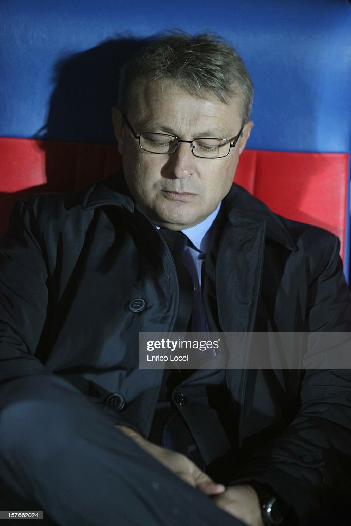 Coach Ivo Pulga of Cagliari sits in the dugout on during the TIM Cup match between Cagliari Calcio and Pescara at Stadio Is Arenas on December 5, 2012 in Cagliari, Italy.