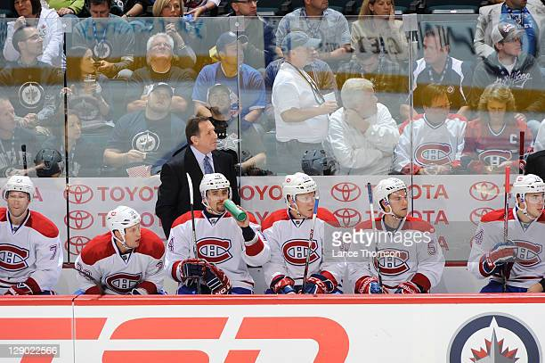 Coach Jacques Martin of the Montreal Canadiens watches play from the bench in the second period versus the Winnipeg Jets at the MTS Centre on October...