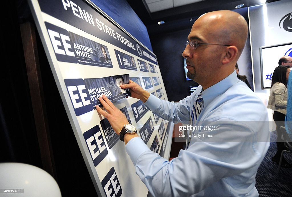 Coach James Franklin places the name of quarterback recruit Michael O'Connor on a board with other recruits as Penn State University football program held a national signing day event in the Lasch building, in University Park, Pa., Wednesday, February 5, 2014.