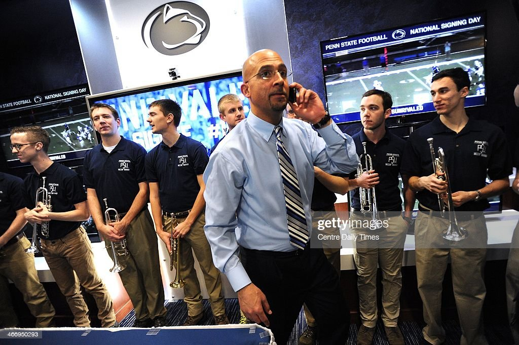 Coach James Franklin talks on the phone to a recruit as Penn State University football program held a national signing day event in the Lasch building, in University Park, Pa., Wednesday, February 5, 2014.