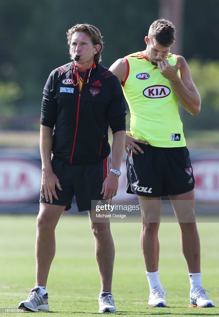 Coach <a gi-track='captionPersonalityLinkClicked' href=/galleries/search?phrase=James+Hird&family=editorial&specificpeople=201975 ng-click='$event.stopPropagation()'>James Hird</a> blows his whistle next to Cale Hooker during a Essendon Bombers AFL training session at Windy Hill on February 14, 2013 in Melbourne, Australia.