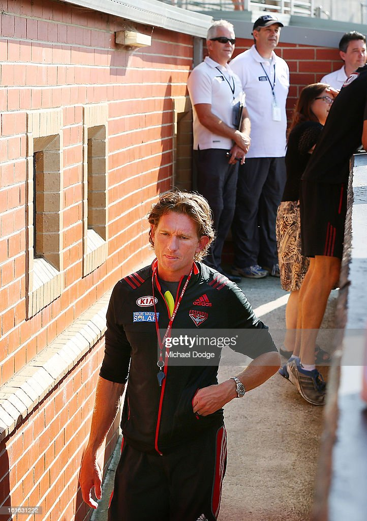 Coach <a gi-track='captionPersonalityLinkClicked' href=/galleries/search?phrase=James+Hird&family=editorial&specificpeople=201975 ng-click='$event.stopPropagation()'>James Hird</a> walks past two ASADA Drug testers waiting to go into the club rooms during a Essendon Bombers AFL training session at Windy Hill on February 14, 2013 in Melbourne, Australia.