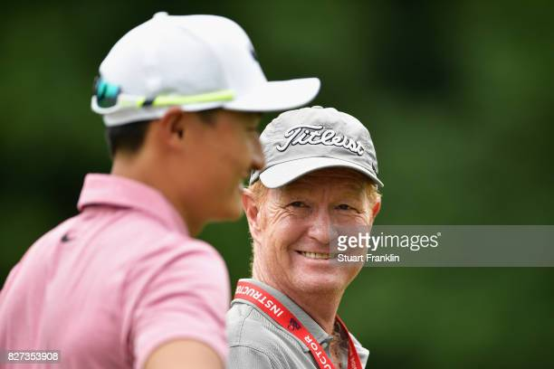 Coach Jamie Gough speaks to Haotong Li of China during a practice round prior to the 2017 PGA Championship at Quail Hollow Club on August 7 2017 in...