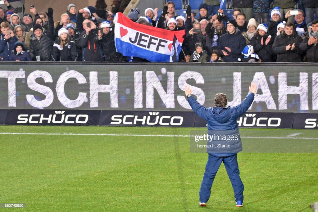 Coach Jeff Saibene (FRONT) of Bielefeld celebrates with his supporters after the Second Bundesliga match between DSC Arminia Bielefeld and FC St. Pauli at Schueco Arena on December 1, 2017 in Bielefeld, Germany.