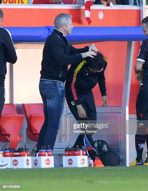 coach Jens Keller and Atsuto Uchida of 1FC Union Berlin after the game between Jahn Regensburg and Union Berlin on october 15 2017 in Regensburg...