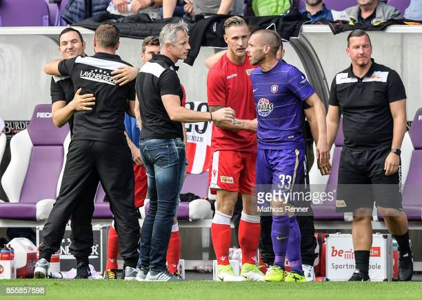 coach Jens Keller of 1 FC Union Berlin and Christian Tiffert of Erzgebirge Aue after the game between FC Erzgebirge Aue and FC Union Berlin on...