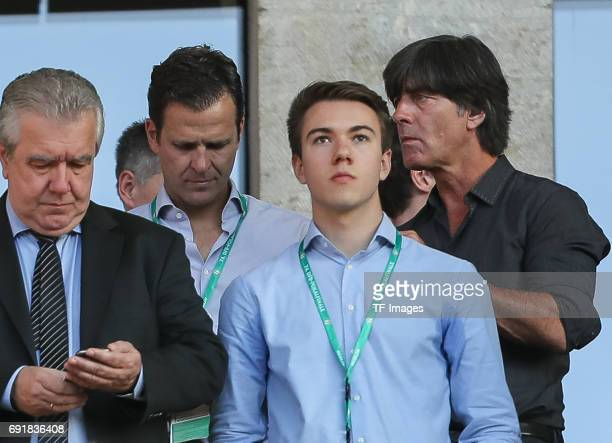 coach Joachim Loew and Oliver Bierhoff looks on during the DFB Cup final match between Eintracht Frankfurt and Borussia Dortmund at Olympiastadion on...