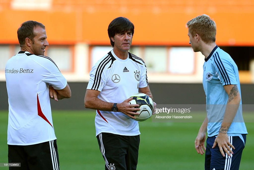 Coach <a gi-track='captionPersonalityLinkClicked' href=/galleries/search?phrase=Joachim+Loew&family=editorial&specificpeople=215315 ng-click='$event.stopPropagation()'>Joachim Loew</a> (C) of Germany and assistent coach Hansi Flick talk to <a gi-track='captionPersonalityLinkClicked' href=/galleries/search?phrase=Marco+Reus&family=editorial&specificpeople=5445884 ng-click='$event.stopPropagation()'>Marco Reus</a> (R) during a training session, on the eve of their FIFA World Cup Brazil 2014 qualifier against Austria, at Ernst-Happel-Stadion on September 10, 2012 in Vienna, Austria.