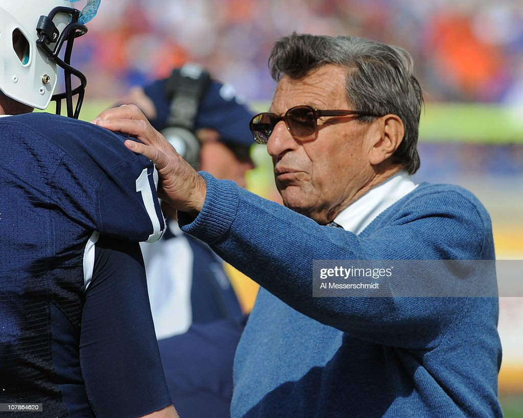 Coach Joe Paterno of the Penn State Nittany Lions directs play of quarterback Matt McGloin #11 against the Florida Gators January 1, 2010 in the 25th Outback Bowl at Raymond James Stadium in Tampa, Florida.