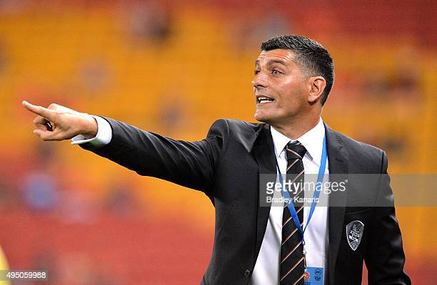 Coach John Aloisi of the Roar gives directions to his players during the round four ALeague match between Brisbane Roar and Adelaide United at...