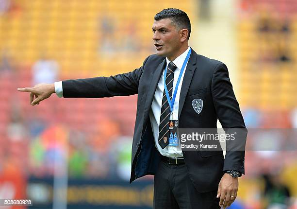 Coach John Aloisi of the Roar gives directions to his players during the round 18 ALeague match between the Brisbane Roar and Central Coast Mariners...