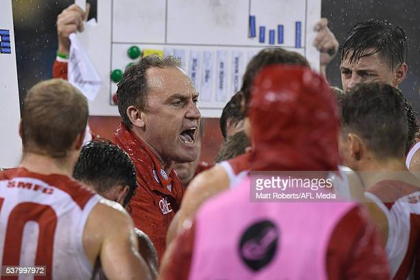 Coach John Longmire of the Swans speaks to his players during the round 11 AFL match between the Gold Coast Suns and the Sydney Swans at Metricon...