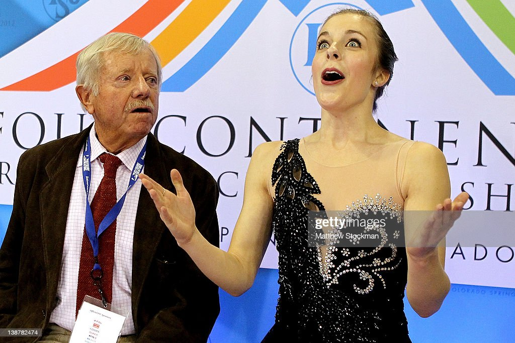 Coach John Nicks and <a gi-track='captionPersonalityLinkClicked' href=/galleries/search?phrase=Ashley+Wagner&family=editorial&specificpeople=2564533 ng-click='$event.stopPropagation()'>Ashley Wagner</a> react to her score in the Ladies Free Skate during the ISU Four Continents Figure Skating Championships at World Arena on February 11, 2012 in Colorado Springs, Colorado. Wagner won the ladies competition.