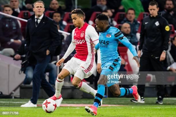 coach John van den Brom of AZ Justin Kluivert of Ajax Ridgeciano Haps of AZduring the Dutch Eredivisie match between Ajax Amsterdam and AZ Alkmaar at...