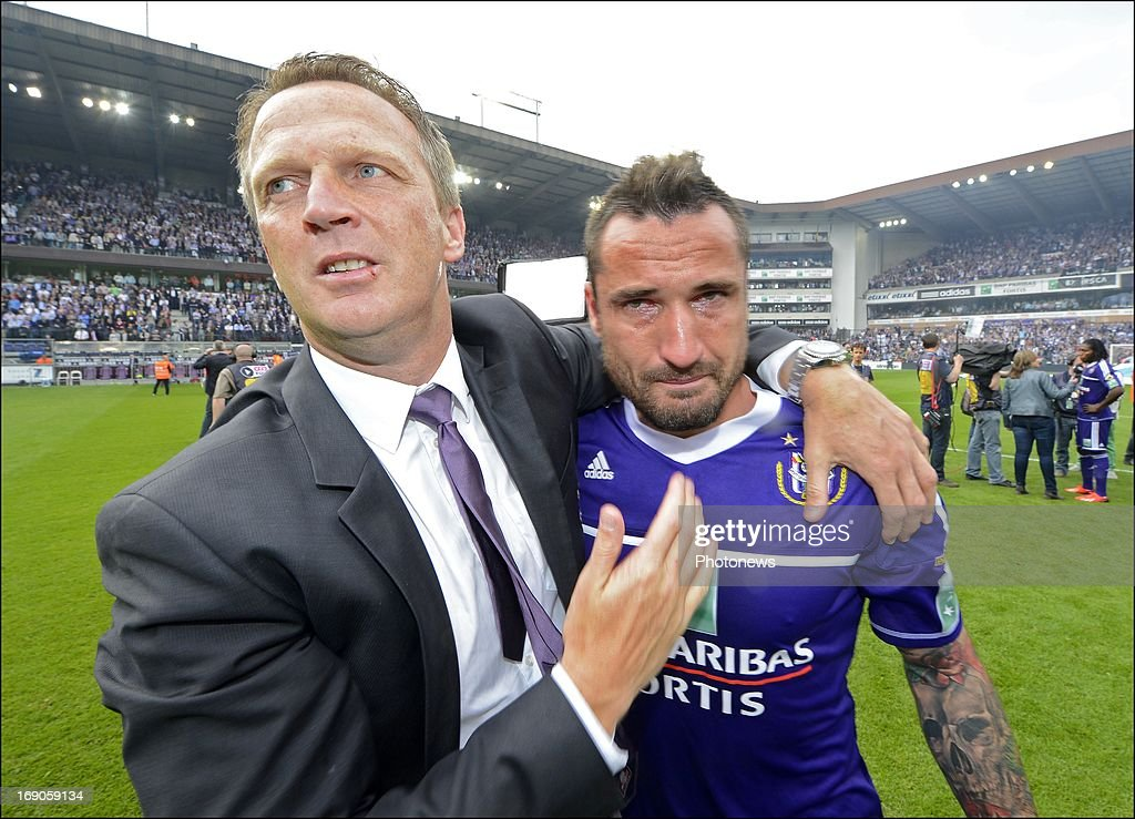 Coach John Van Den Brom of RSC Anderlecht and Marcin Wasilewski of RSC Anderlecht celebrates winning the Jupiler League title 2012 - 2013 for the 32nd time in the history of the club on May 19, 2013 in Anderlecht, Belgium.