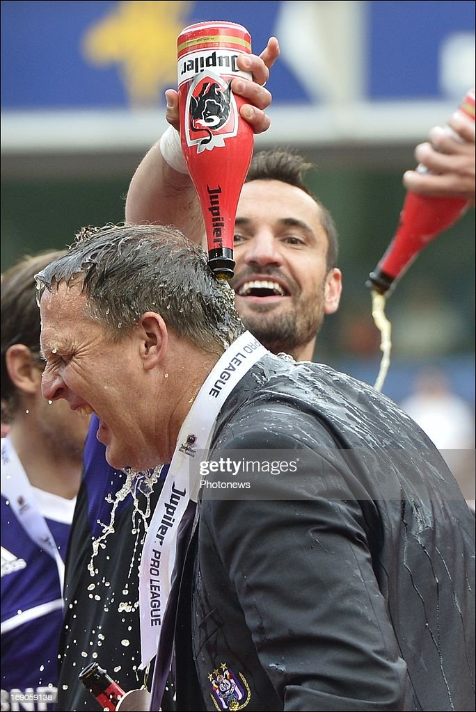 Coach John Van Den Brom of RSC Anderlecht and Marcin Wasilewski of RSC Anderlecht celebrate winning the Jupiler League title 2012 - 2013 for the 32nd time in the history of the club on May 19, 2013 in Anderlecht, Belgium.