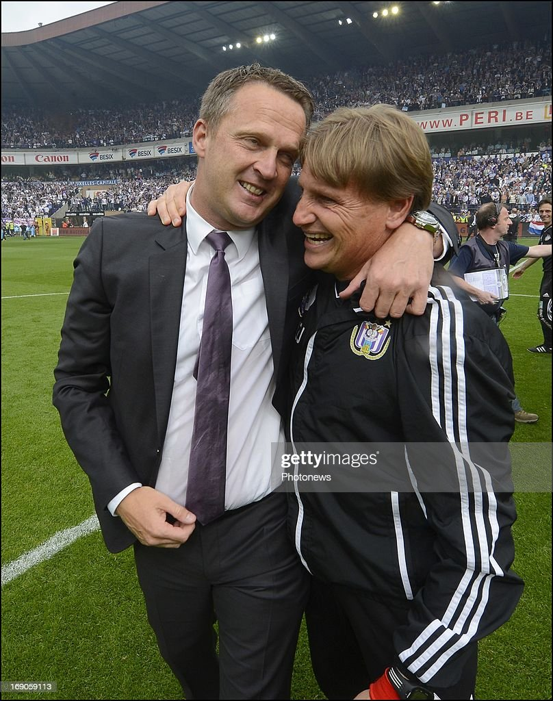 Coach John Van Den Brom of RSC Anderlecht and Max De Jong celebrates winning the Jupiler League title 2012 - 2013 for the 32nd time in the history of the club on May 19, 2013 in Anderlecht, Belgium.