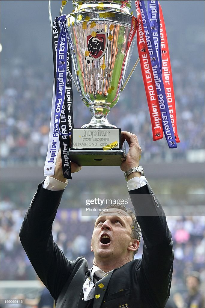Coach John Van Den Brom of RSC Anderlecht celebrates winning the Jupiler League title 2012 - 2013 for the 32nd time in the history of the club on May 19, 2013 in Anderlecht, Belgium.