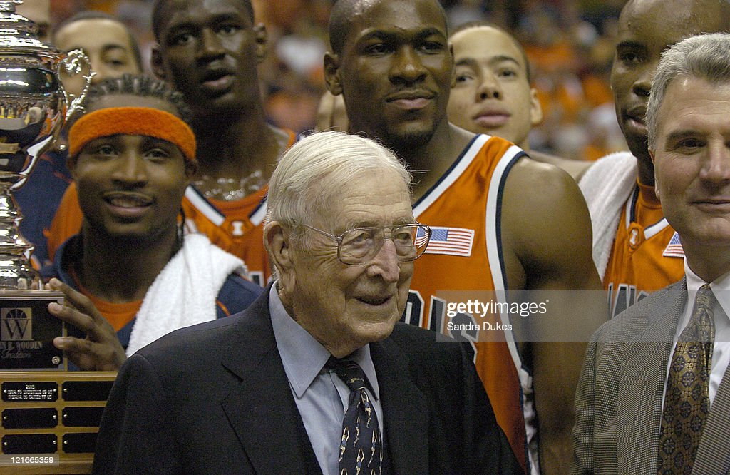 Coach <a gi-track='captionPersonalityLinkClicked' href=/galleries/search?phrase=John+Wooden&family=editorial&specificpeople=2124480 ng-click='$event.stopPropagation()'>John Wooden</a> with Dee Brown, Coach <a gi-track='captionPersonalityLinkClicked' href=/galleries/search?phrase=Bruce+Weber+-+Basketball+Coach&family=editorial&specificpeople=15087708 ng-click='$event.stopPropagation()'>Bruce Weber</a> and other members of the winning Illinois team after Illinois 89-70 win in the <a gi-track='captionPersonalityLinkClicked' href=/galleries/search?phrase=John+Wooden&family=editorial&specificpeople=2124480 ng-click='$event.stopPropagation()'>John Wooden</a> Tradition in Conseco Fieldhouse, Indianapolis on November 27, 2004