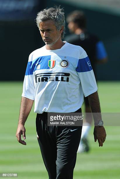 Coach José Mourinho walks away after talking with Inter Milan forward Zlatan Ibrahimovic as they train at the Rose Bowl on the eve of their game...