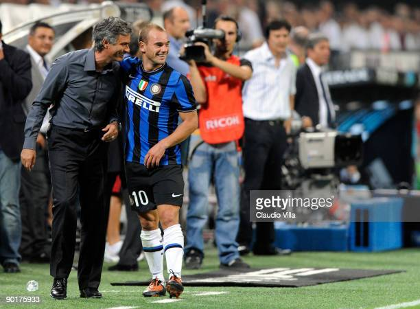 Coach Jose Mourinho and Wesley Sneijder of Inter FC celebrate during the Serie A match between AC Milan and Inter Milan at Stadio Giuseppe Meazza on...