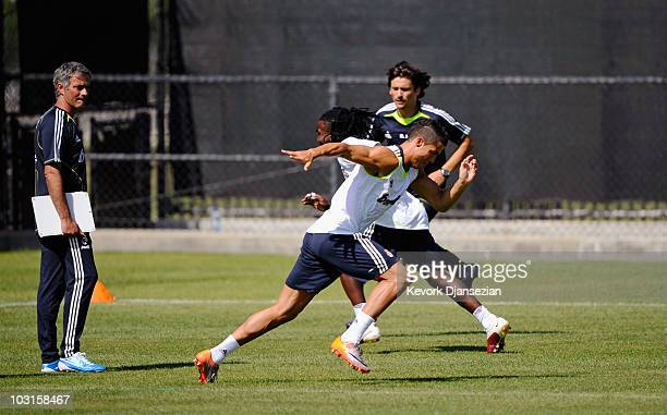 Coach Jose Mourinho of Real Madrid looks at forward Cristiano Ronaldo and midfielder Drenthe during training session on July 29 2010 in Los Angeles...