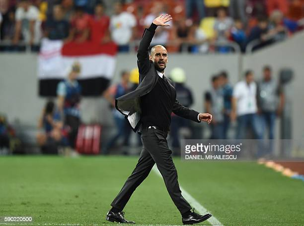 Coach Josep Guardiola of Manchester City celebrates victory after the UEFA Champions league first leg playoff football match between Steaua Bucharest...