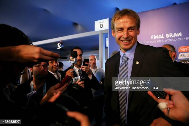 USA coach Juergen Klinsmann speaks to members of the media after the Final Draw for the 2014 FIFA World Cup Brazil at Costa do Sauipe Resort on...